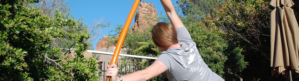 Stick Mobility Movement Specialists Jennifer Tillman stretching on a Stretch Mobility orange stick